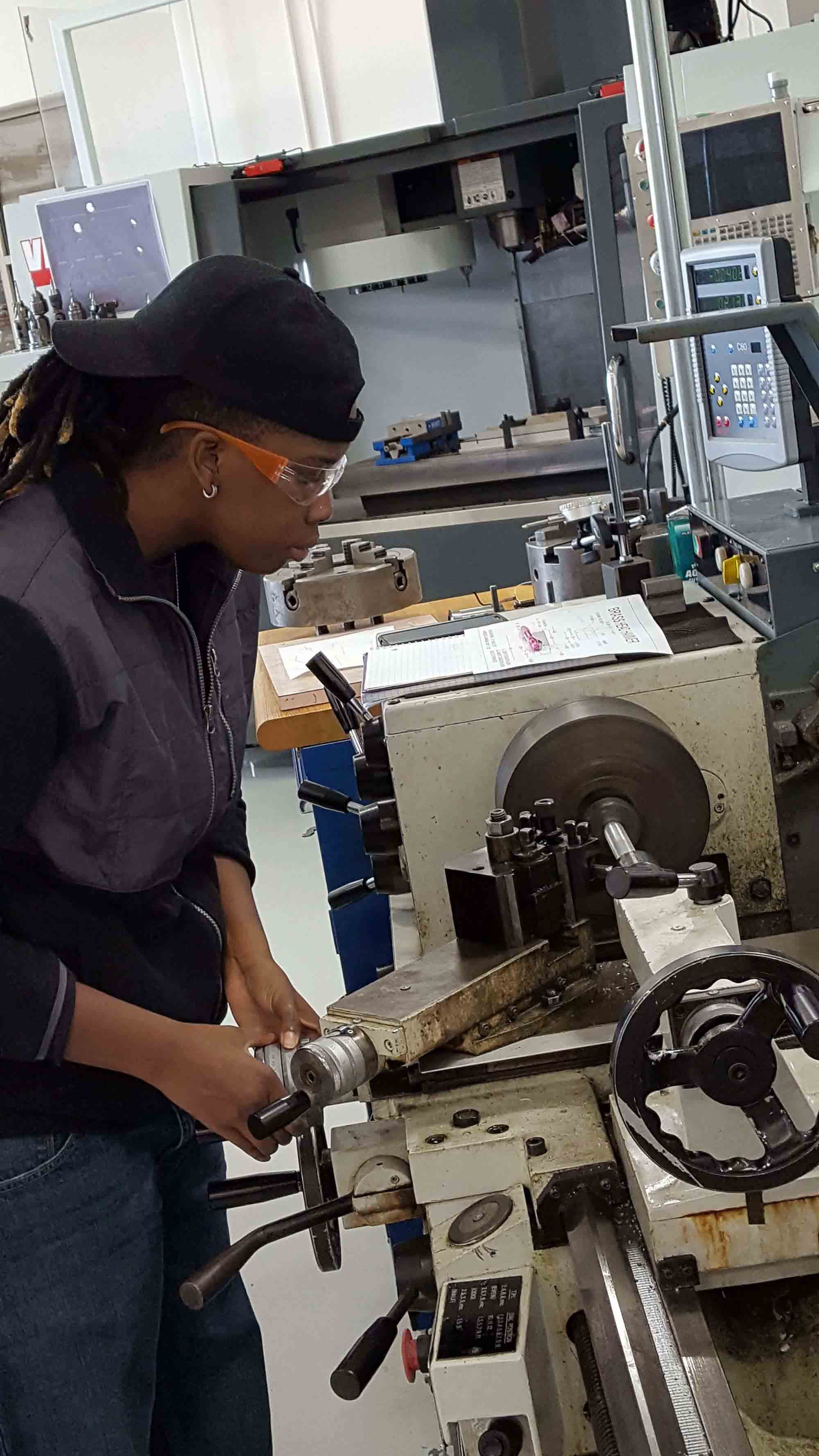 Woman Using Manufacturing Equipment