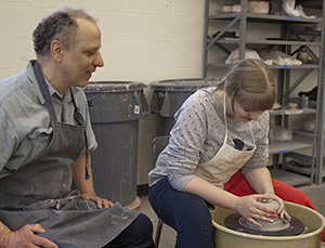 Ceramics student with instructor