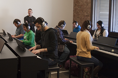 students learning piano